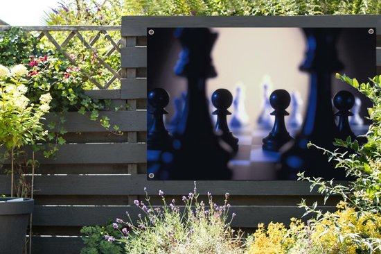 De zwarte pionnen van het schaken tuinposter 180x120 cm - Tuindoek / Buitencanvas / Schilderijen voor buiten (tuindecoratie) XXL